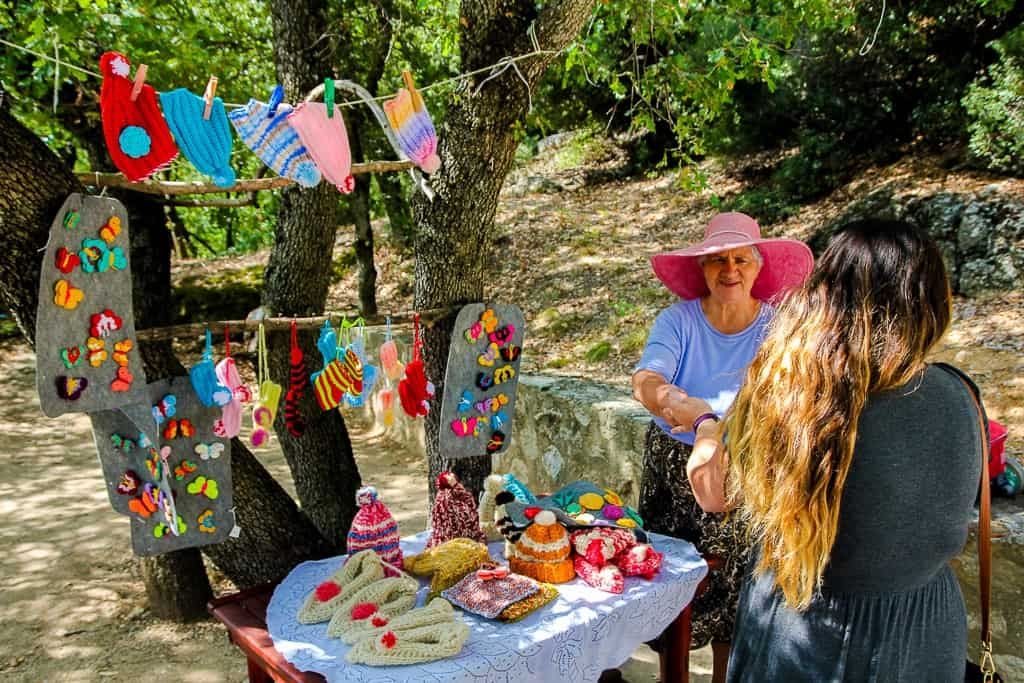 Woman selling handmade goods at St. Nicholas