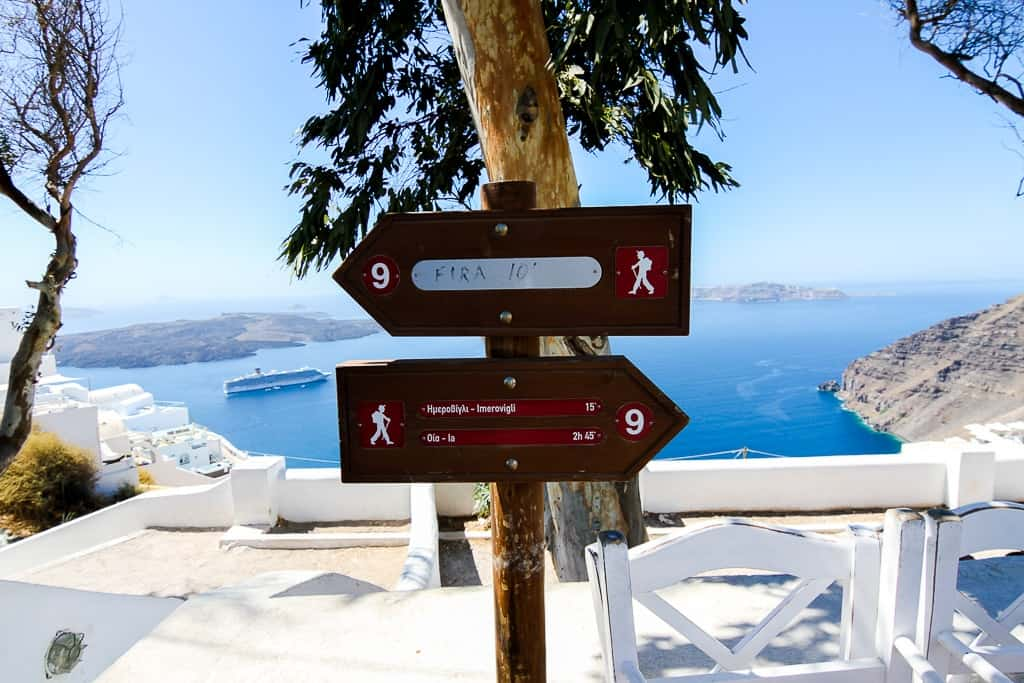 Signs indicating the hike distance between Thira and Oia which is one of the things to do in Santorini