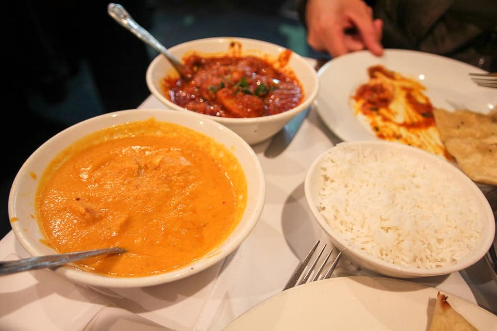 A curry on brick lane is one of the food experiences to have in London