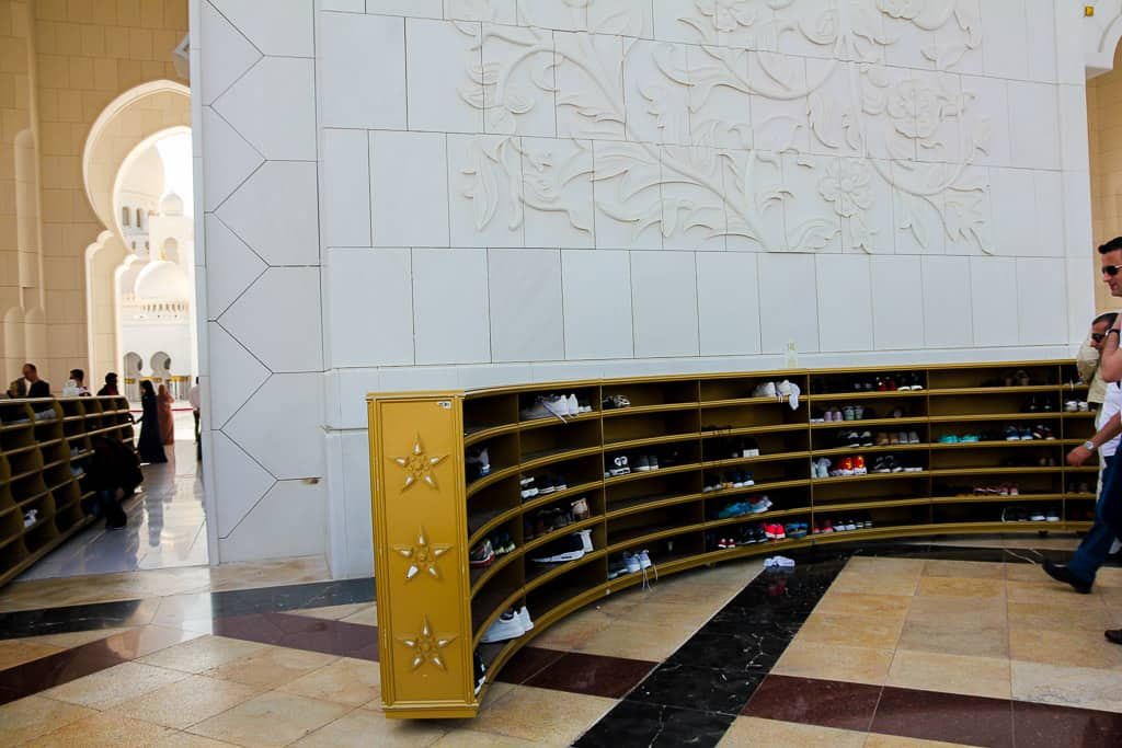 The shoe racks where you have to leave your shoes before entering the mosque