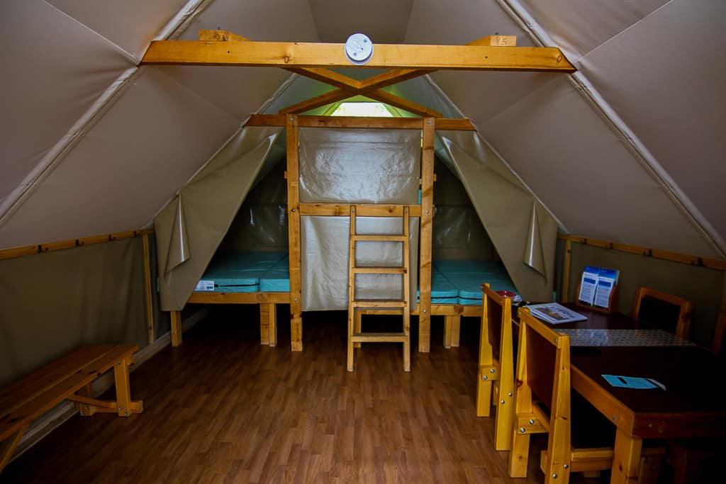 The inside of the oTENTik camps highlighting what's inside the tent