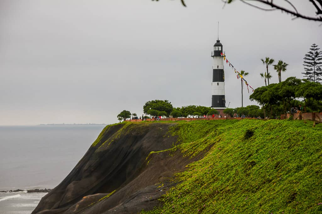 Taking selfies with the La Marina Lighthouse is one of the things to do in Miraflores