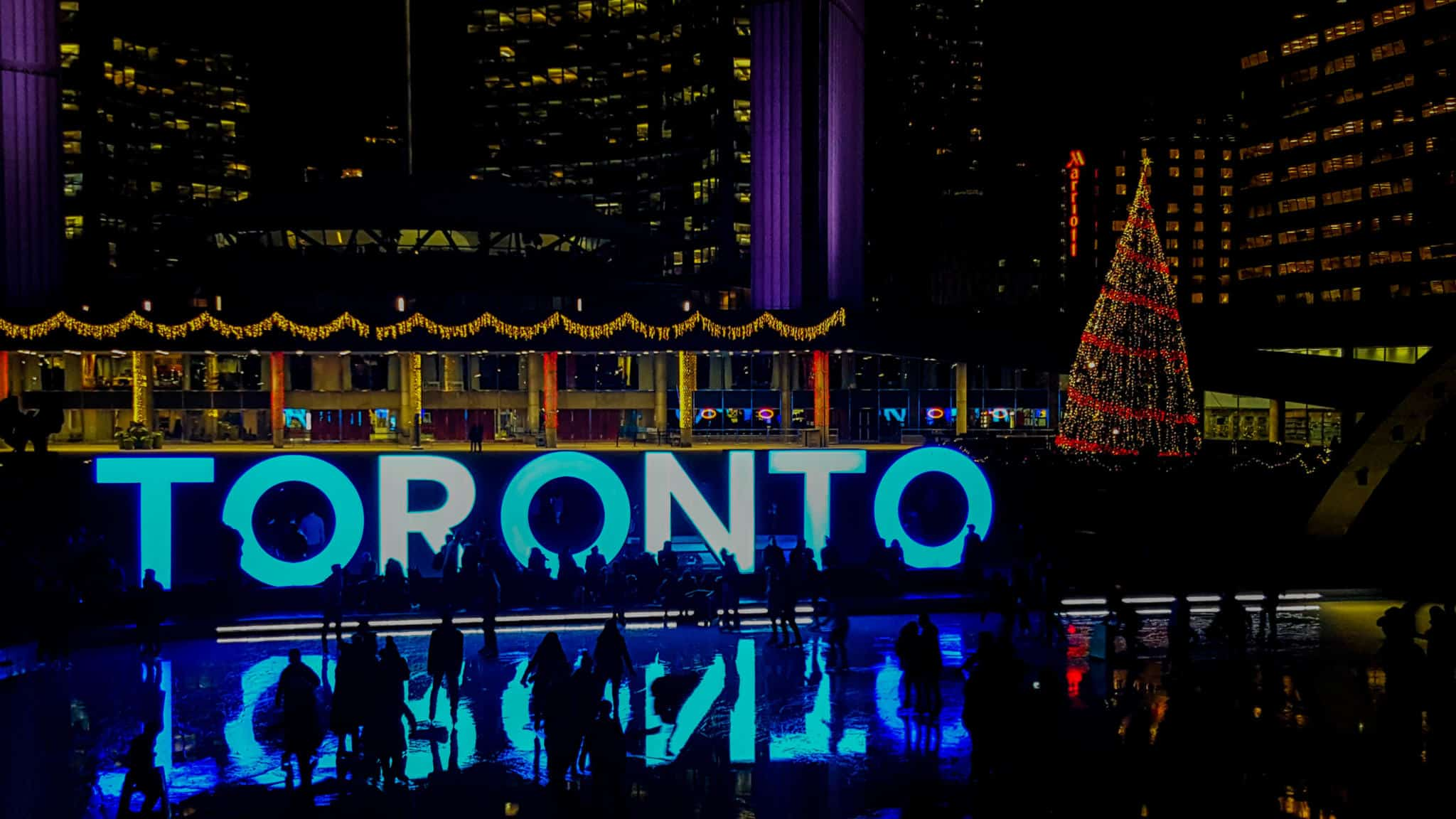 Taking a picture at the Toronto Sign is one of the free things to do in Toronto