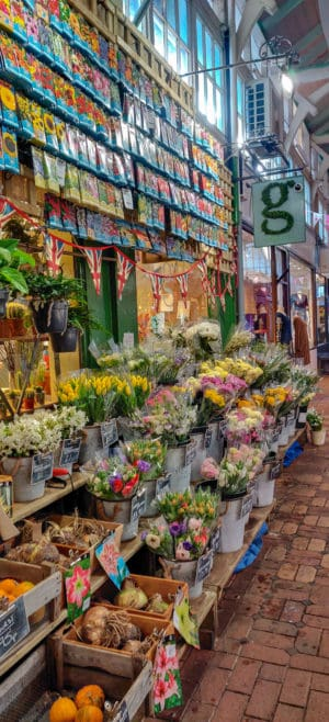 A flower stand in the Oxford Market which is one of the things to see during an Oxford Day Trip