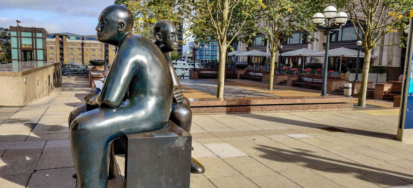 Two men on a bench statue